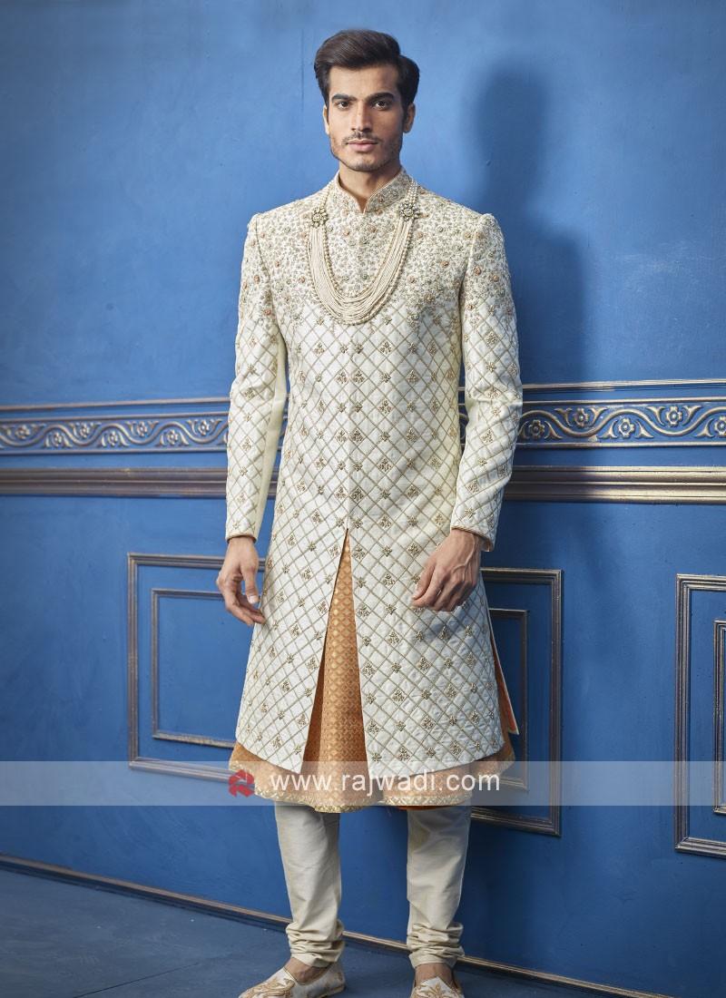 stylish off white and orange sherwani