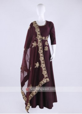 Tapeta silk anarkali suit in dark magenta color