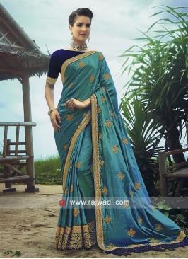 Teal  art silk saree with contrast blouse.