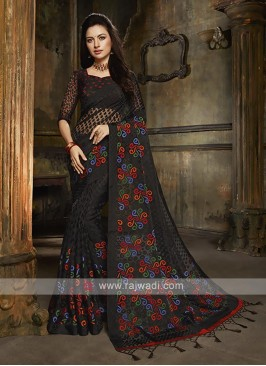 Tissue brasso saree in black color