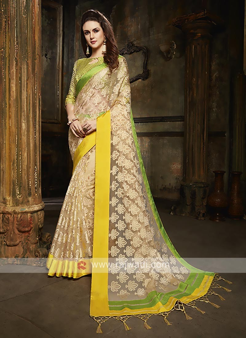Tissue brasso saree in cream color