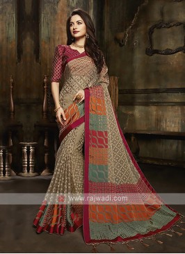 Tissue brasso saree in golden brown color