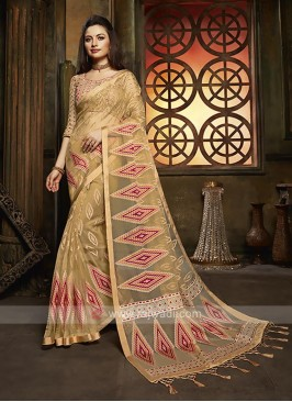 Tissue brasso saree in golden color