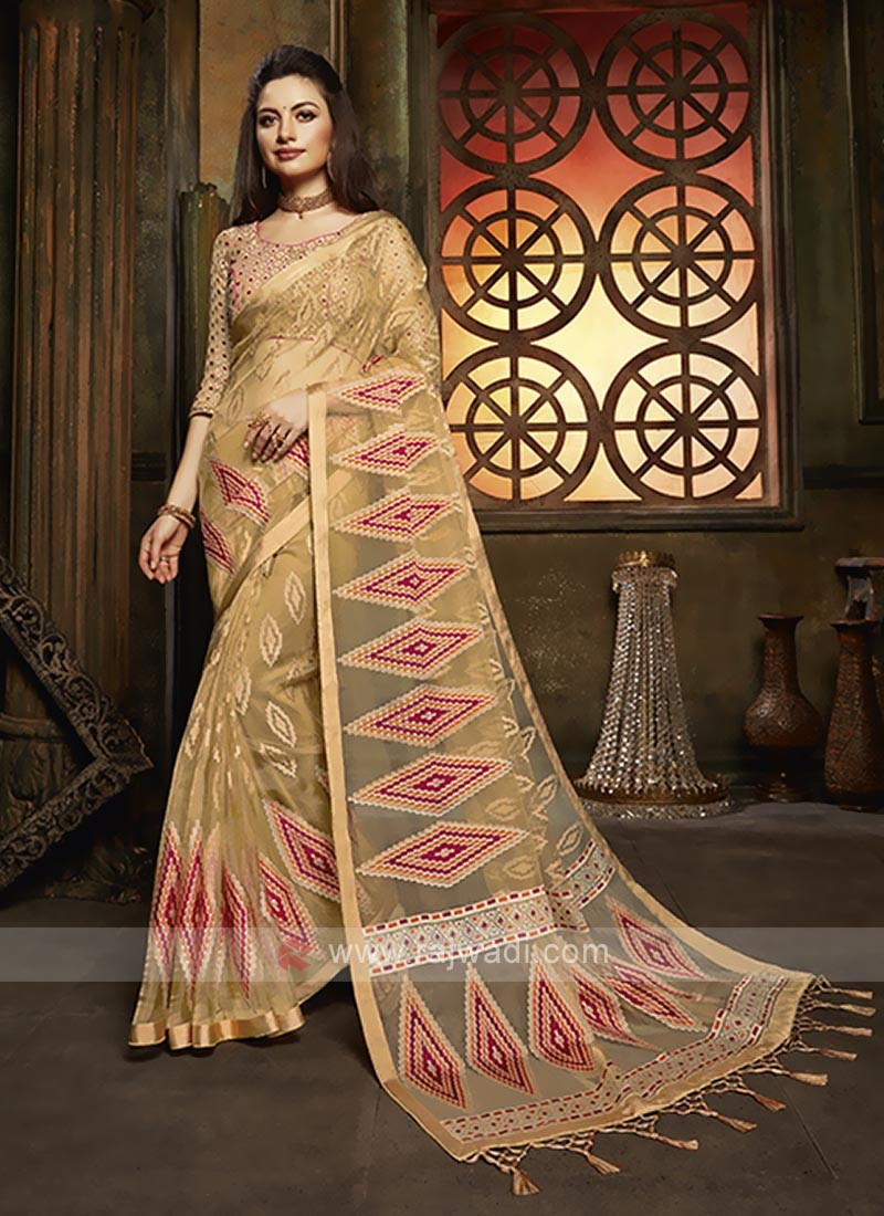 Tissue brasso saree in golden color