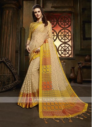 Tissue brasso saree in golden cream color