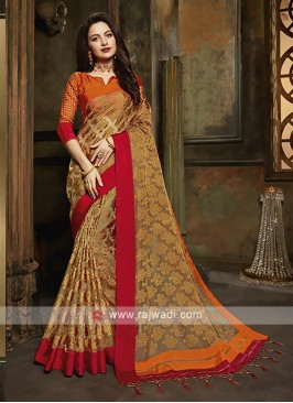 Tissue brasso saree in golden rod color