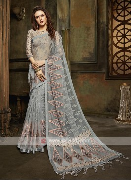 Tissue brasso saree in grey color