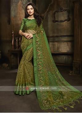 Tissue brasso saree in mehndi green color