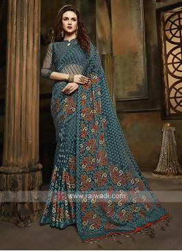 Tissue brasso saree in peacock blue color