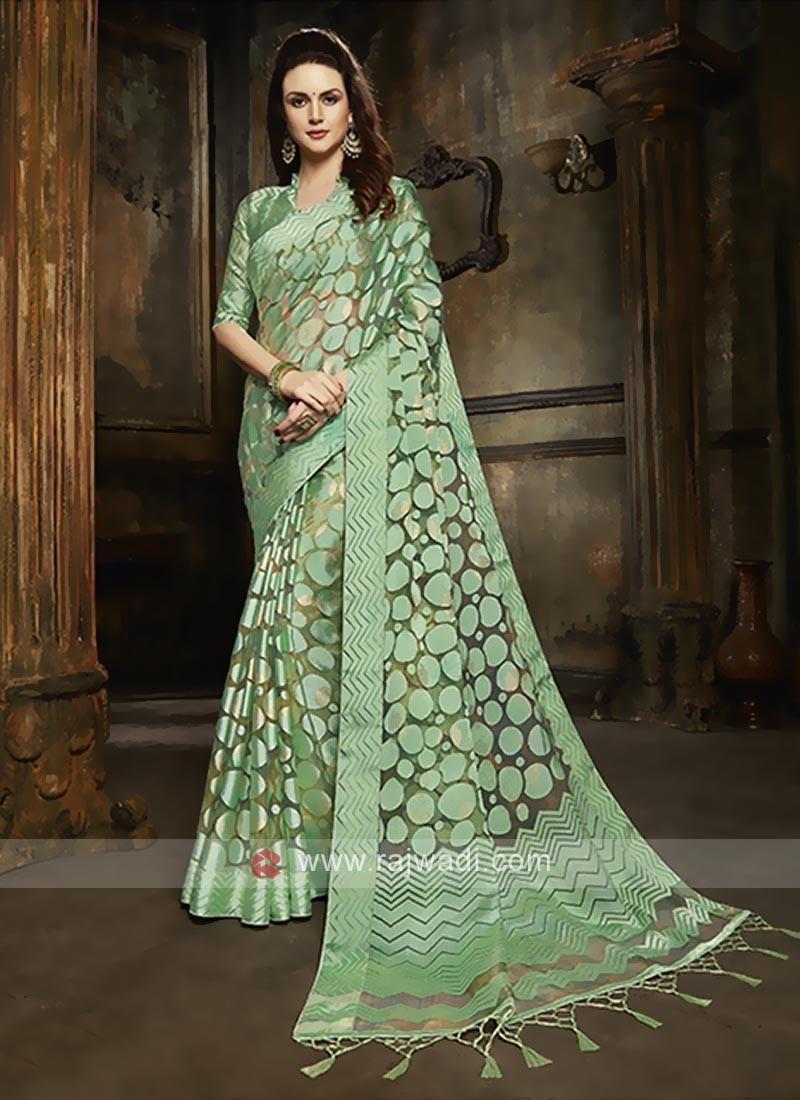 Tissue brasso saree in pista green color