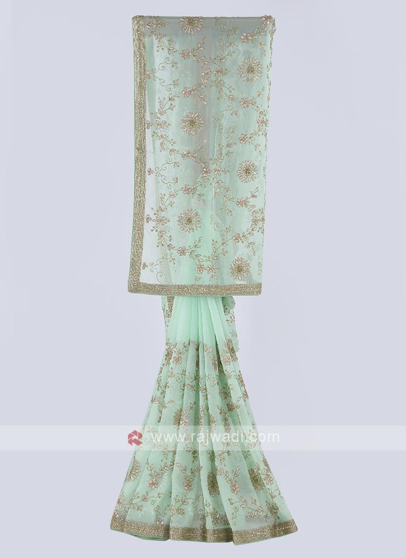 Tissue chiffon saree in pista green color