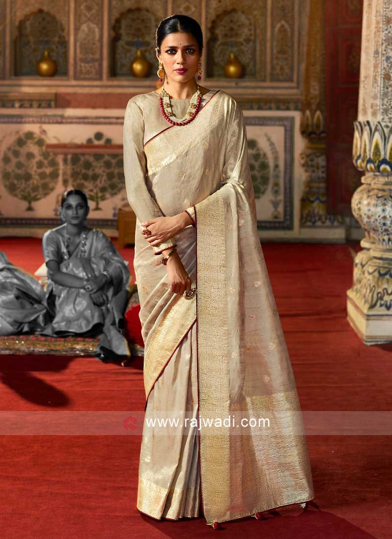 Traditional Look In Tan Color Art Raw Silk Saree