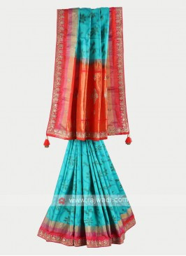 Turquoise and rust color pure silk saree