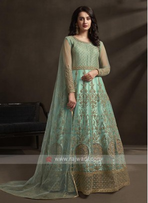 Turquoise color unsticthed anarkali suit
