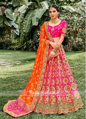 Unstiched Silk Lehenga Choli In Rani And Orange