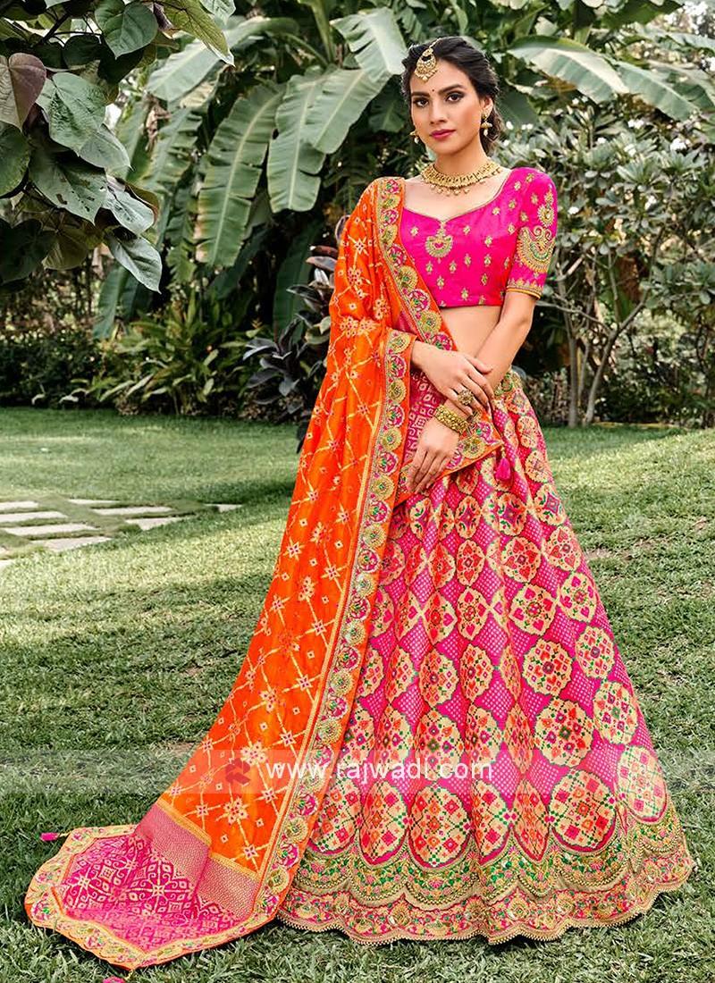 Unstiched Silk Lehenga Choli In Rani And Orange
