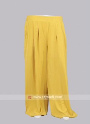 Women Yellow color Solid Straight Palazzos