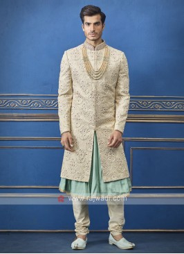 wonderful cream and pista sherwani