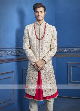 wonderful cream and rani sherwani