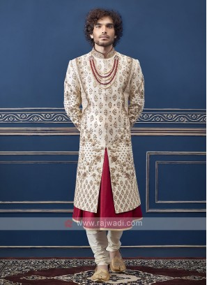 wonderful cream and red sherwani