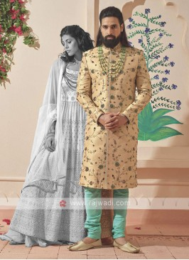 wonderful golden and sea green sherwani