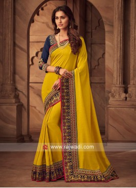 Yellow Border Work Saree with Dark Blue Blouse