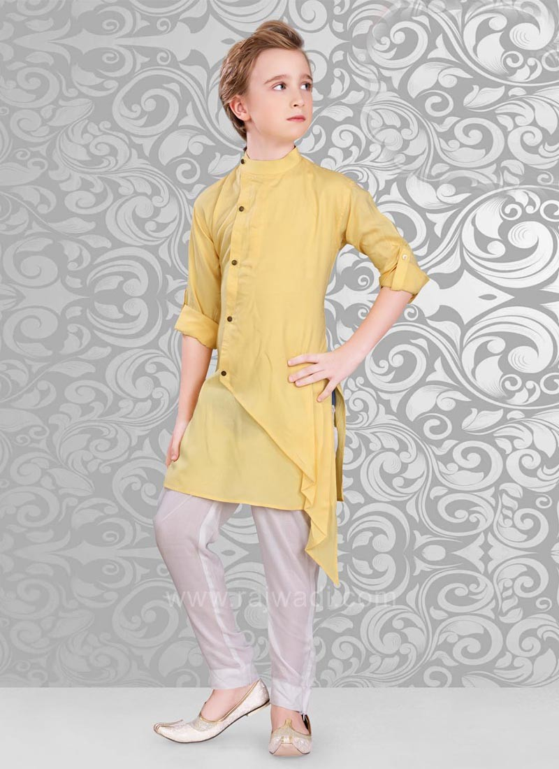 Yellow Color Kurta And Off White Color Bottom.