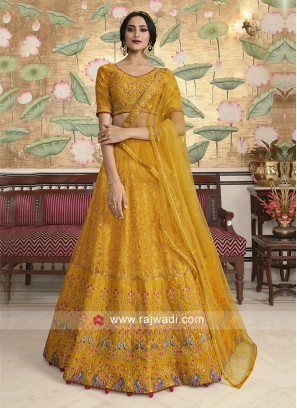 Yellow net fabric lehenga choli