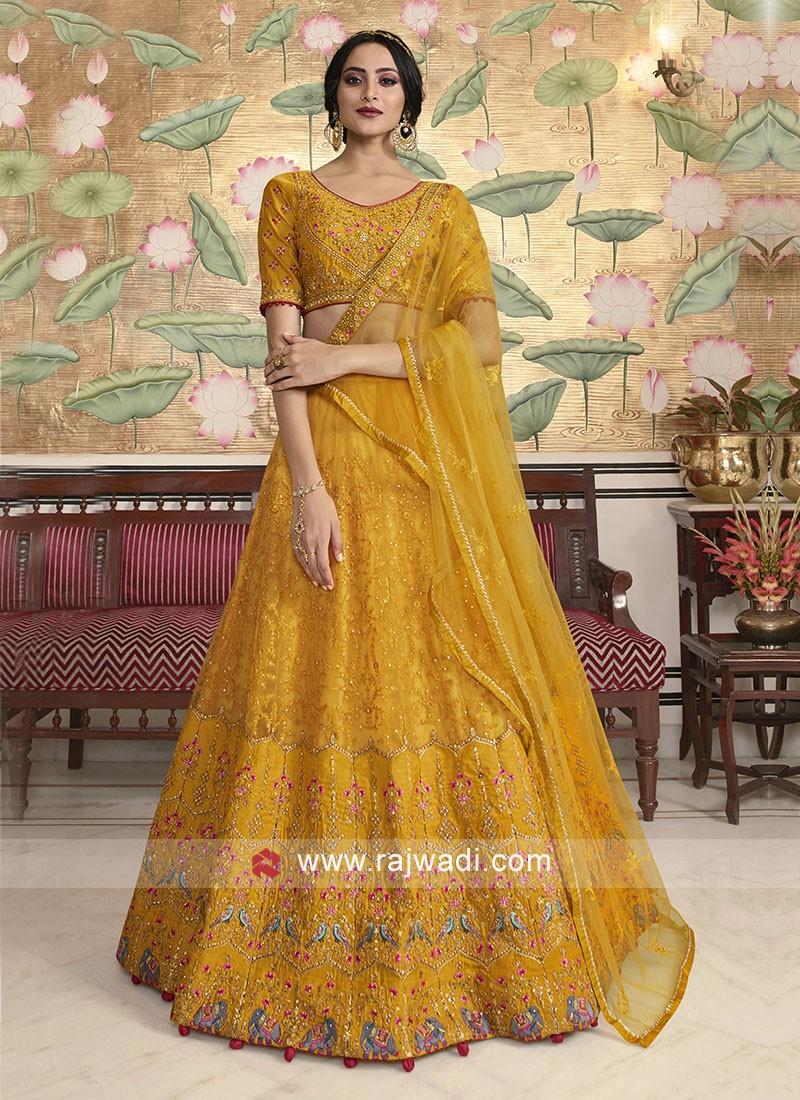 Yellow net fabric lehenga choli