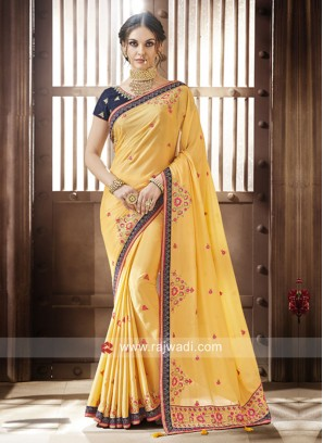 Yellow Saree with Dark Blue Blouse