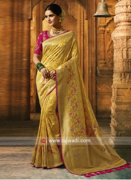 Yellow Saree with Deep Pink Heavy Blouse